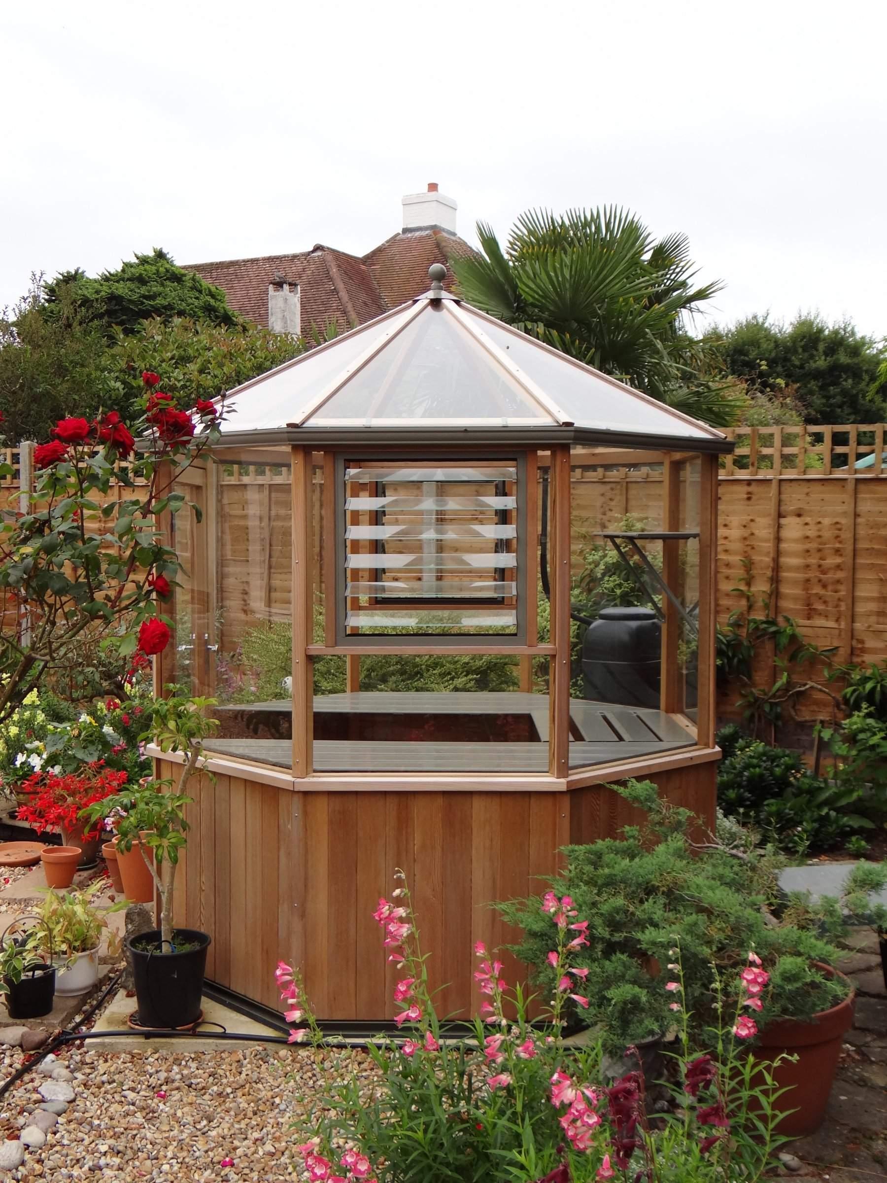 Evolution Octagonal Cedar Greenhouse 6 6 X 6 6 Alton Greenhouses Backyard greenhouse brown county